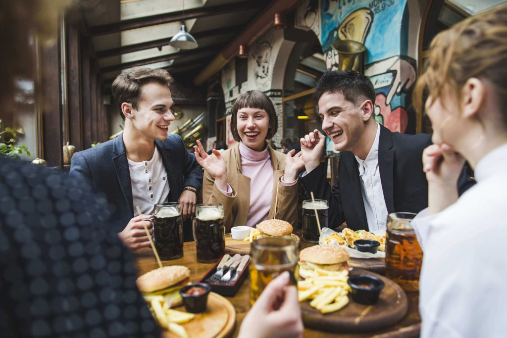 group-friends-eating-restaurant